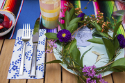 A fresh flower crown coordinates with dishes by Ted Baker for Portmeirion