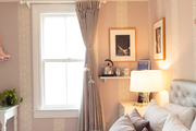 A feminine bedroom of white, purple, and pink