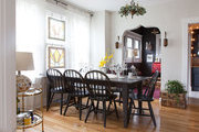 A dark-stained wood table in a dining room