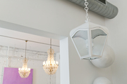 A trio of light fixtures at Buckingham Interiors + Design
