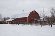 A red barn in winter.