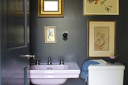 A pink pedestal sink in a powder room