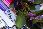 A colorful flower crown on an alfresco party table