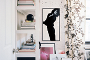 Floral curtains and layered framed art
