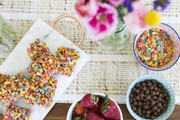 An overhead detail of cereal and breakfast treats.