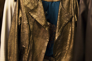 A detail of a gold jacket.