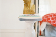 A bust on a white side table