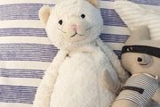 Stuffed animals on a child's bed