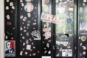 A bedroom door covered with stickers