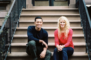 Arnel Andrada and Bryn Sanders on the front stoop of their Brooklyn apartment
