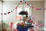 Paper tassels hang over a spring tabletop