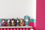 Painted dolls arrayed atop a painted radiator in a Paris apartment