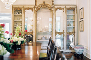 An antique china cabinet in a formal dining space