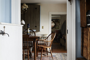 Open dutch doorway into a rustic dining room.