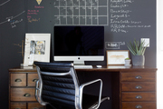 A contemporary workspace with a chalkboard-painted wall.