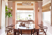 Soft pink walls and a high-gloss ceiling in a dining room