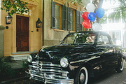 A vintage car celebrates Bastille Day in Charleston, South Carolina