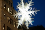 A large glowing snowflake in a holiday display