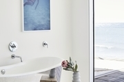 """""""With work and kids, I don't get much time to unwind during the week, so I try to make the most of my moments that I do."""" Ryan MacFarland Artwork   Magnus Home Products Bathtub   Kalon Side Table   Amazon Bathmat   Maaari Ceramics."""