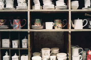 White and marbleized ceramic pieces on shelves
