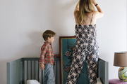 Chloe Warner and her son in his bedroom, putting up art he chose himself