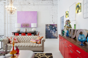 A chesterfield sofa and red console at Buckingham Interiors + Design