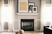 A vaulted ceiling in a gray-walled living space