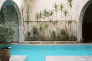 Architectural arches spanning a courtyard pool