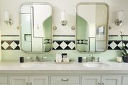Green and white Spanish-style bathroom.