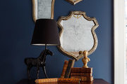 Shield-shaped framed mirrors above vintage library card cabinet.