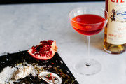 A Campari-Lillet cocktail paired with pomegranate-garnished oysters