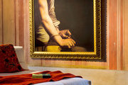 A reproduction of a famous Caravaggio painting next to a contemporary daybed