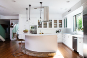 A modern kitchen with white cabinets.