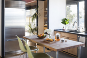 Kitchen with island in the center. Black beans and mid-century modern stools.