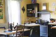 Yellow walls and variegated gray stripes in a spacious kitchen