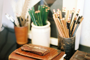 Leather journals and office supplies on a desktop