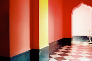 Red and yellow walls in a hallway