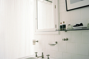 White tile and a pedestal sink in a bathroom