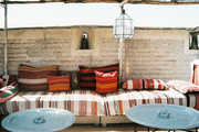 An outdoor lounge area furnished with striped cushions