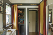 A pantry kitchen and entry to a laundry room in a guest house