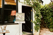 A painting easel set up on a brick patio