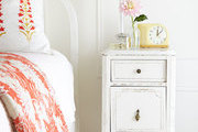 A small bedside table in a master bedroom