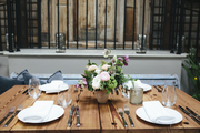 Set natural wood table with small potted plant.