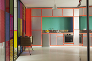 Built-in cabinets and stained glass in a Paris kitchen