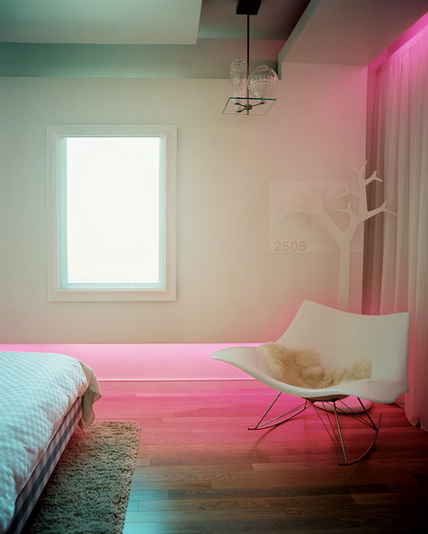 Bedroom - A molded-plastic rocking chair in a neutral bedroom