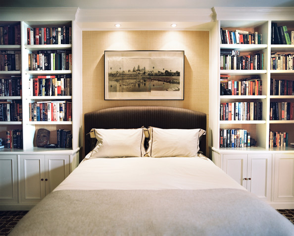 Bedroom - An upholstered bed flanked by white built-in bookcases