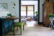 Open space living area with blue, brown, and green accents.