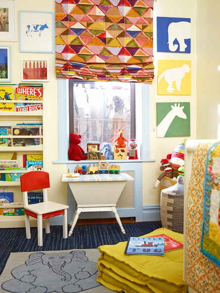 Blue Bookshelf - Bright colors and animal prints in a kid's bedroom