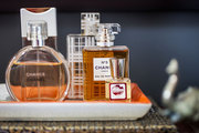 A collection of perfumes on an orange ceramic tray
