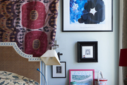 The master bedroom showcases a welcoming mix of textiles and art.